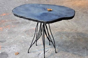 side table made of natural stone and steel